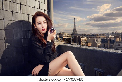Beijing, china- june 20, 2019: chinese actress Dili reba wearing Black suit Showing YSL MON PARIS FLORAL EAU DE PARFUM, sexy and pretty Chinese woman