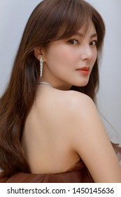 Beijing, china- june 20, 2019: chinese actress Zhang yuqi wearing Brown Strapless dress and BVLGARI diamond Jewelry, sexy and pretty Chinese woman