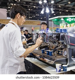 BEIJING, CHINA- JUNE 28, 2017:  A man prepares coffee at the Lavazza booth during the Expo Finefood Beijing 2017 at the China National Convention Center