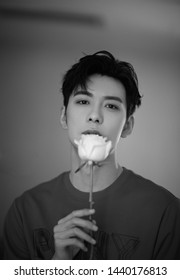Beijing, china- June 28,2019: Famous Chinese young actor Chen xingxu holding a rose flower on mouth, black and white picture , Handsome model, chinese movie and teleplay star