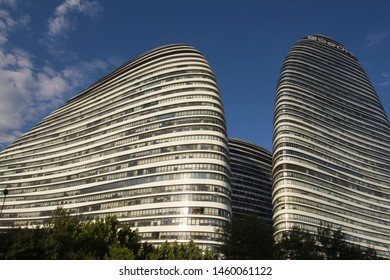 Beijing, China - June 29, 2019: Architectural details of Wangjing SOHO, a complex of three curvilinear asymmetric skyscrapers in Wangjing, a suburb of Beijing. It was designed by architect Zaha Hadid.
