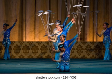 BEIJING, CHINA - JUNE 4: Balancing the spinning plates performed on stage. June 4, 2009 in Beijing, China.