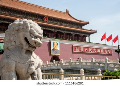 Beijing, China – June 5 2018: The entrance of the famous Forbidden palace city with the portrait chairman Mao Zedong and the Chinese guardian lions statue in Beijing, China.