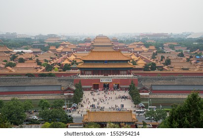 Beijing, China – June 5 2018:  Panoramic view of Forbidden palace city from Beihai park hill  with  crowd of Tourist at the northern gate exit of   the Palace Museum  in Beijing, China.