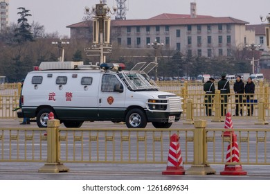 Beijing, China - Mar 16, 2018: Vehicle and guards of the Chinese People's Armed Police Force, known as PAP, outside the Tienanmen Square in Beijing.
