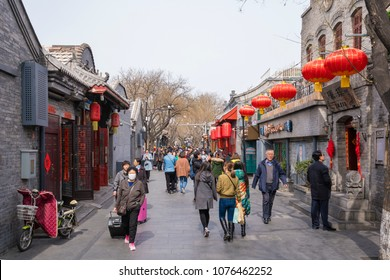 Beijing, China - Mar 20, 2018: People visiting a traditional hutong in Beijing. Hutong is an alley in traditional residential aeras in northern Chinese cities, especially Beijing.