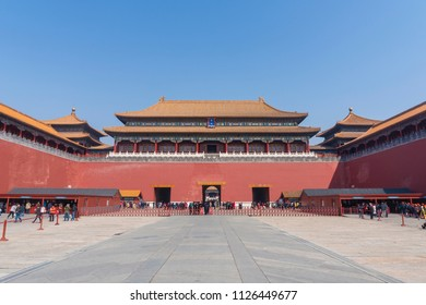 Beijing, China - Mar 22, 2018: View of people visiting the Forbidden City in Beijing. It is a palace complex in Beijing and a popular tourist attraction.