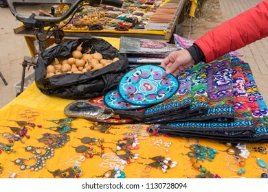 Beijing, China - Mar 23, 2018: Buying handicraft at 798 Art Zone in Beijing. It is a district characterized by modern art and exhibition of Chinese culture and art.
