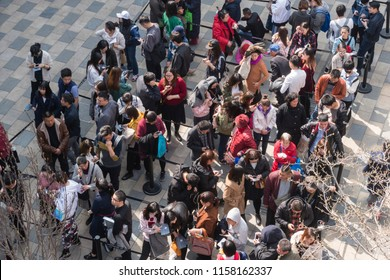 Beijing, China - Mar 24, 2018: People queuing up for an event in a shopping mall in Beijing.