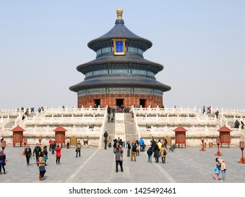 Beijing / China - Mar 25 2013: Temple of Heaven in Beijing, China (Tian Tan in Beijing, China) with tourists. Tiantan literally means Altar of Heaven. Translation: Hall of Prayer for Good Harvests.