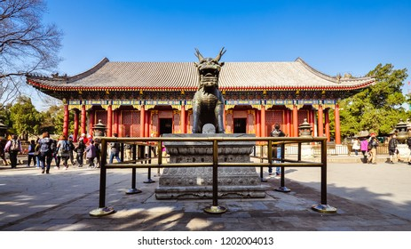 Beijing, China - Mar. 28, 2012: Tourists visit the Hall of Benevolence and Longevity, Summer Palace, Beijing, China.