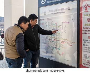 BEIJING, CHINA- MARCH 08, 2017: People take a look of the subway map at the China International Exhibition Center Station. Beijing Subway network has 19 lines.