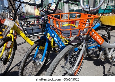 """Beijing, China - March 12, 2017: Three bicycles of """"Mobike"""" , """"Bluegogo"""" and """"Ofo"""" lined up. They are the most popular fully station-less bicycle-sharing system in the city of China."""