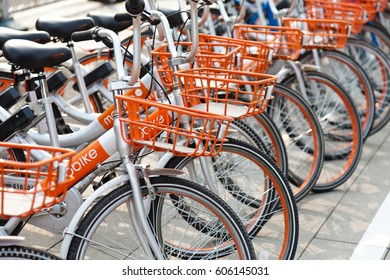 "Beijing, China - March 21, 2017: Many orange bicycles of ""Mobike"" lined up. Mobike fully station-less bicycle-sharing system is one of the world's largest bicycle operator."