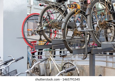 Beijing / China - March 22, 2015: Bicycles stacked at a parking lot near Zhongguancun station of Beijing Subway
