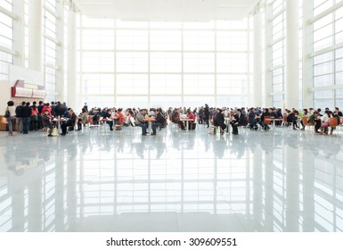 BEIJING, CHINA - MARCH 26, 2012: Visitors have lunch in the bright and high dining area of China International Exhibition Center in Beijing,China on March 26, 2012.