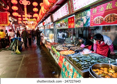 BEIJING, CHINA - MARCH 26: Tourists and food sellers at Wangfujing Snack Street on March 26, 2013 in Dongcheng District, Beijing