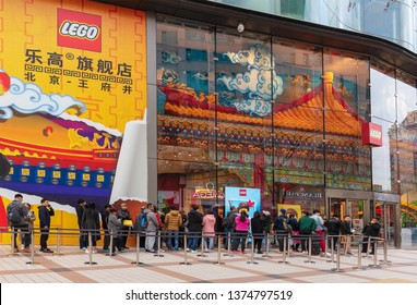 BEIJING, CHINA- MARCH 31, 2019: People queue outside a Lego Store in Wangfujing commercial area at city downtown.