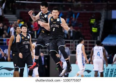 Beijing, China - March 5, 2019:  Fang Shuo and Zhang Cairen celebrate after winning a CBA game between Beijing Ducks and Fujian SBS on March 5, 2019, in Beijing, China.