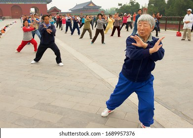 Beijing, China - May 01, 2009: Group of senior people practice tai chi chuan gymnastics outdoors in Beijing, China.