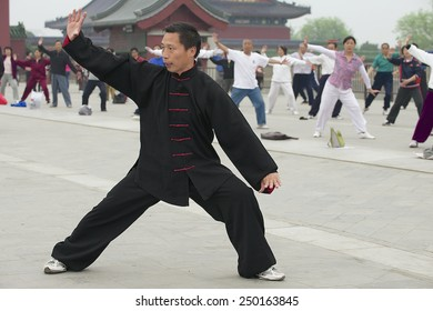 BEIJING, CHINA - MAY 01, 2009: Unidentified people practice tai chi chuan gymnastics on May 01, 2009 in Beijing, China.