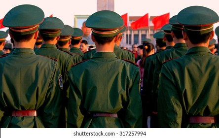 Beijing, China - May 1, 2005:  Rows of Chinese soldiers stand at attention during the evening lowering of the flag ritual in Tiananmen Square