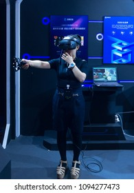 BEIJING, CHINA - May 10-13, 2018: First ever American DEFCON hacker conference held in Beijing. Cellphone photo shows a participant wearing VR headset powered by Baidu, co-host of the event,