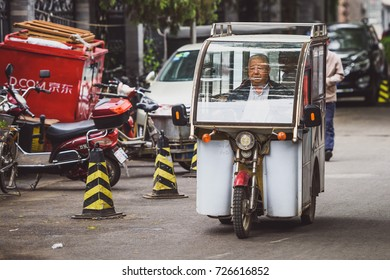 BEIJING, CHINA - MAY 12, 2016: Motorised tuk tuk in Beijing streets