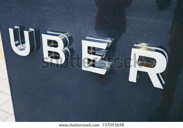 BEIJING, CHINA - MAY 13, 2016: Uber pickup point. Uber - Company of San Francisco, established under the eponymous mobile application for searching, calling and paying a taxi or private drivers