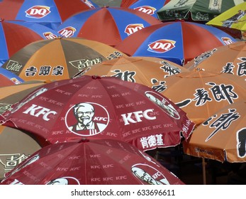 BEIJING, CHINA - MAY 19, 2011: Colorful sun umbrellas with logos of brands