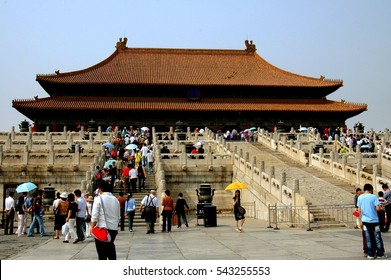 Beijing, China - May 2, 2005:  Two marble staircases lead to the Hall of Supreme Harmony (Tai He Dian) at the Forbidden City