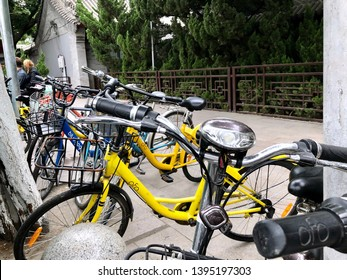 Beijing, China - May 20, 2018: View of OFO share bikes parked beside the streets in Beijing, China. Ofo is a Beijing-based bicycle sharing company founded in 2014.