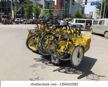 Beijing, China - May 23, 2018: View of transferring  OFO share bikes in the road at Beijing, China. Ofo is a Beijing-based bicycle sharing company founded in 2014.