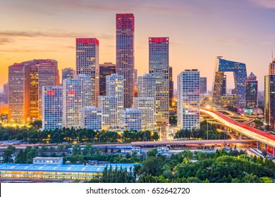 Beijing, China modern financial district skyline at dusk.