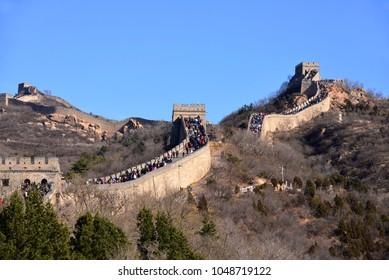 Beijing, China - November 11, 2017:  A large crowd of people visit the world famous Great Wall of China on a sunny day.