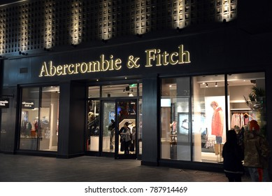 Beijing, China - November 11, 2017:  People shop at night at the Abercrombie & Fitch, an American retailer, in the Sanlitun district known for its international chain stores.