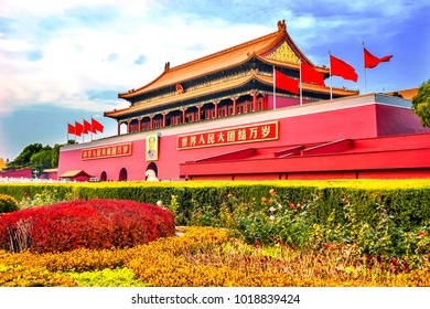 "BEIJING, CHINA - NOVEMBER 13, 2017Mao Tse Tung Tiananmen Gate Gugong Forbidden City Palace Wall Beijing China.  English Translation Chinese ""Long Live Peoples Republic China and Long Live Unity World'"