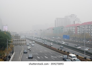 BEIJING, CHINA - NOVEMBER 14, 2015: Zhongguancun street in beijing during air pollution. Air pollution is a serious problem in Beijing.