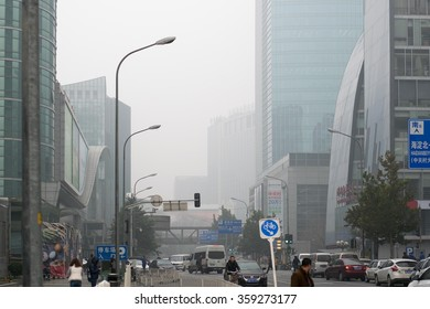 BEIJING, CHINA - NOVEMBER 14, 2015: Buildings on Zhongguancun street during air pollution. Air pollution is a serious problem in Beijing.