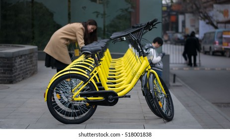 BEIJING, CHINA - NOVEMBER 18, 2016: Rows of bicycles are placed on the side of the road in Beijing. Ofo Bikes is the new bike sharing company in China.