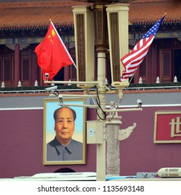 Beijing, China - November 9, 2017:  US and Chinese flags are on display outside the Forbidden City are for the State Visit Plus of President Donald Trump.