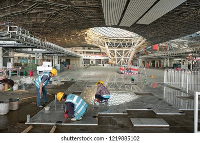 Beijing / China - October 10th 2018: Workers constructing new Beijing Daxing International Airport, to be open on 30 September 2019. It is expected to be the world's largest airport upon completion.