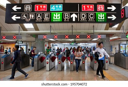 BEIJING, CHINA - October 12, 2013: passengers are seen at a Beijing subway station.  Beijing's 14 subway lines carry over 10 million passengers on an average weekday.