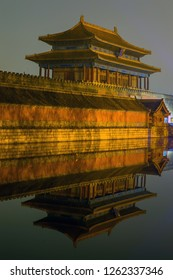 Beijing / China - October 17th 2014: The Gate of Divine Might, the northern gate of the Forbidden City (Palace Museum), reflecting in the water moat.