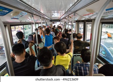 BEIJING, CHINA - OCTOBER 2, 2016: People crowds a bus at city downtown during the National Day holiday, celebrating the 67th anniversary of the founding of the People's Republic of China.