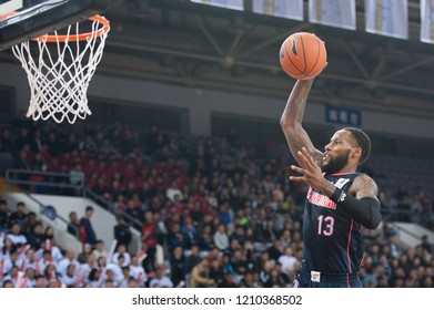Beijing, China - October 23, 2018: Sonny Weems dunks during a CBA game between Beijing Fly Dragon and Guangdong Tigers, on October 23, 2018, in Beijing, China.