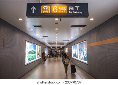 BEIJING, CHINA - OCTOBER 24, 2014: The entrance of Beijing Subway. People are walking. Located in Beijing Subway, Beijing, China.