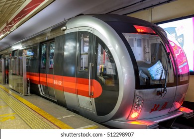 Beijing, China - October 24, 2016: A futuristic-looking train is ready to drive away from a Line-1 station in Beijing Subway.