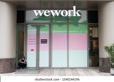 Beijing, China - October 24, 2019: A WeWork Joint office banner is shown out of a business building in Beijing, China.