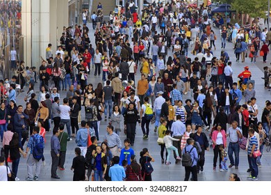 BEIJING, CHINA - OCTOBER 3, 2015: Unidentified people crowd Xidan commercial area during the National Day holiday, the 66th anniversary of the founding of the People's Republic of China.